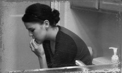StandUpGirl woman sits in bathroom