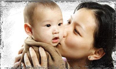 StandUpGirl mother kisses baby son on cheek