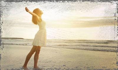 StandUpGirl girl stands in sun on beach