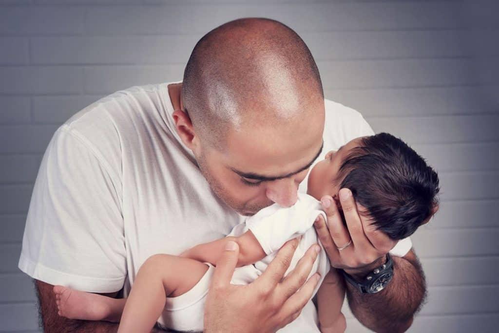 Dad loving his baby