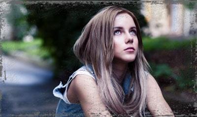 StandUpGirl sad girl looks at sky