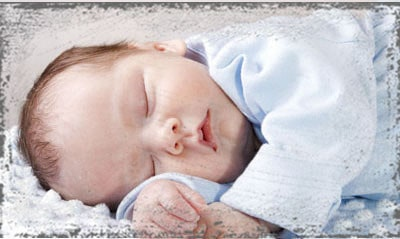 StandUpGirl baby boy sleeping
