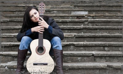 StandUpGirl girl with guitar on steps