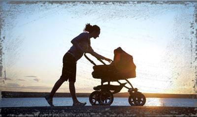 StandUpGirl mom pushing stroller in sun
